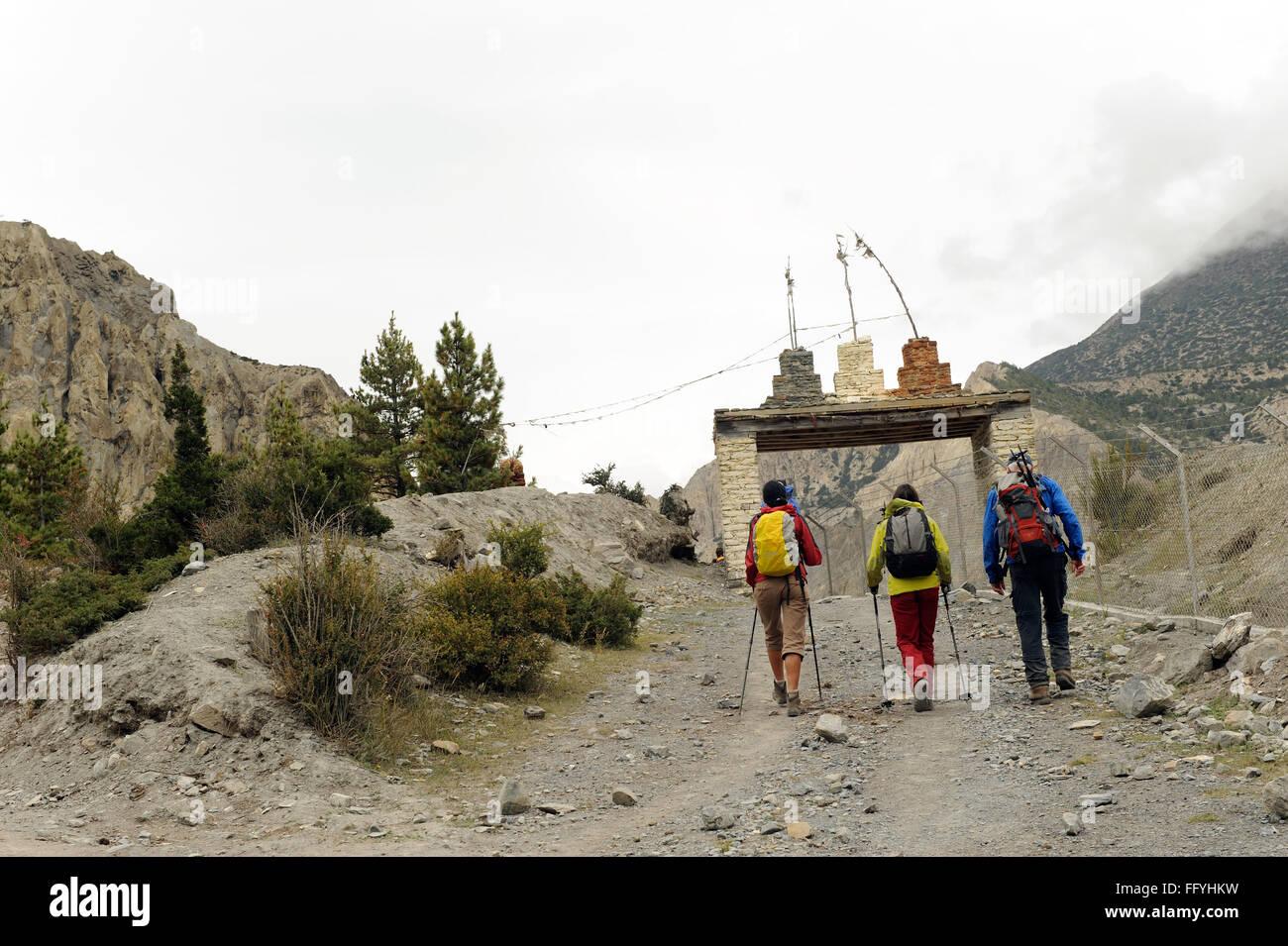 Trekkers at entrance of Braka ; Nepal - Stock Image