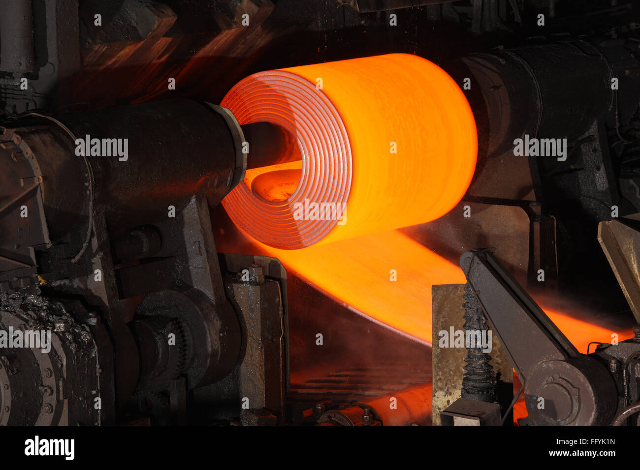 Red Hot Steel Coil in steel factory India - - Stock Image