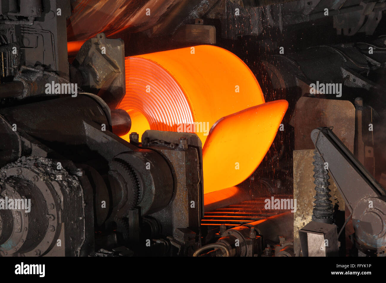 Red Hot Steel Coil in steel factory India - Stock Image