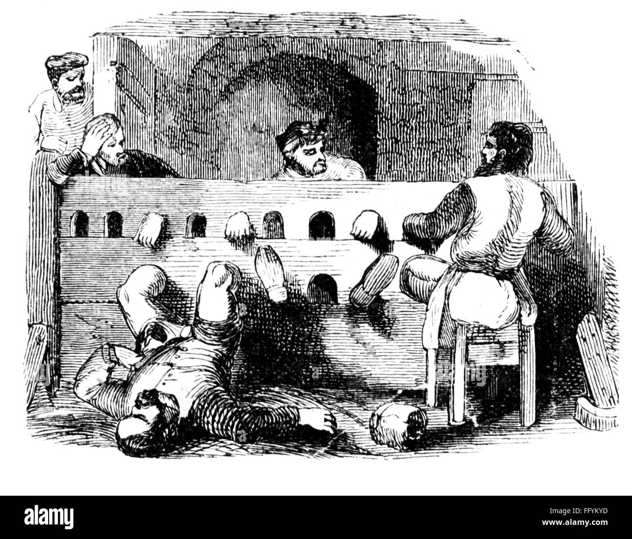 justice, torture, tightened Spanish boot, wood engraving, circa 1912, Additional-Rights-Clearences-NA - Stock Image