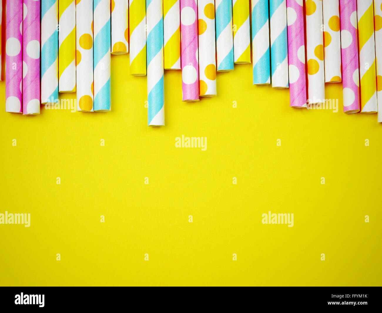 High Angle View Of Colorful Straws Against Yellow Background - Stock Image