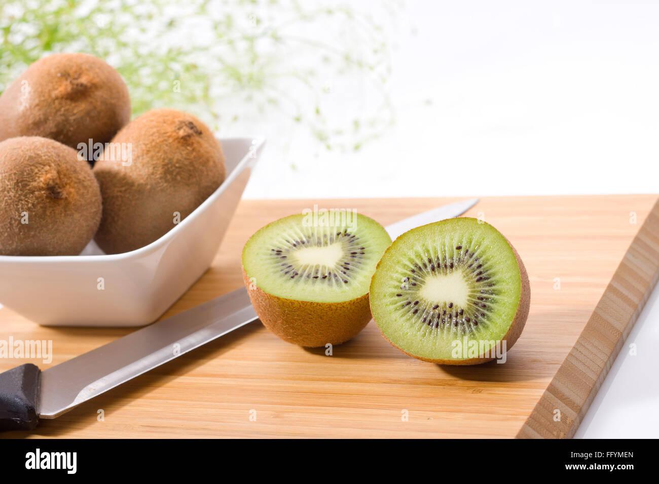 kiwi in bowl - Stock Image
