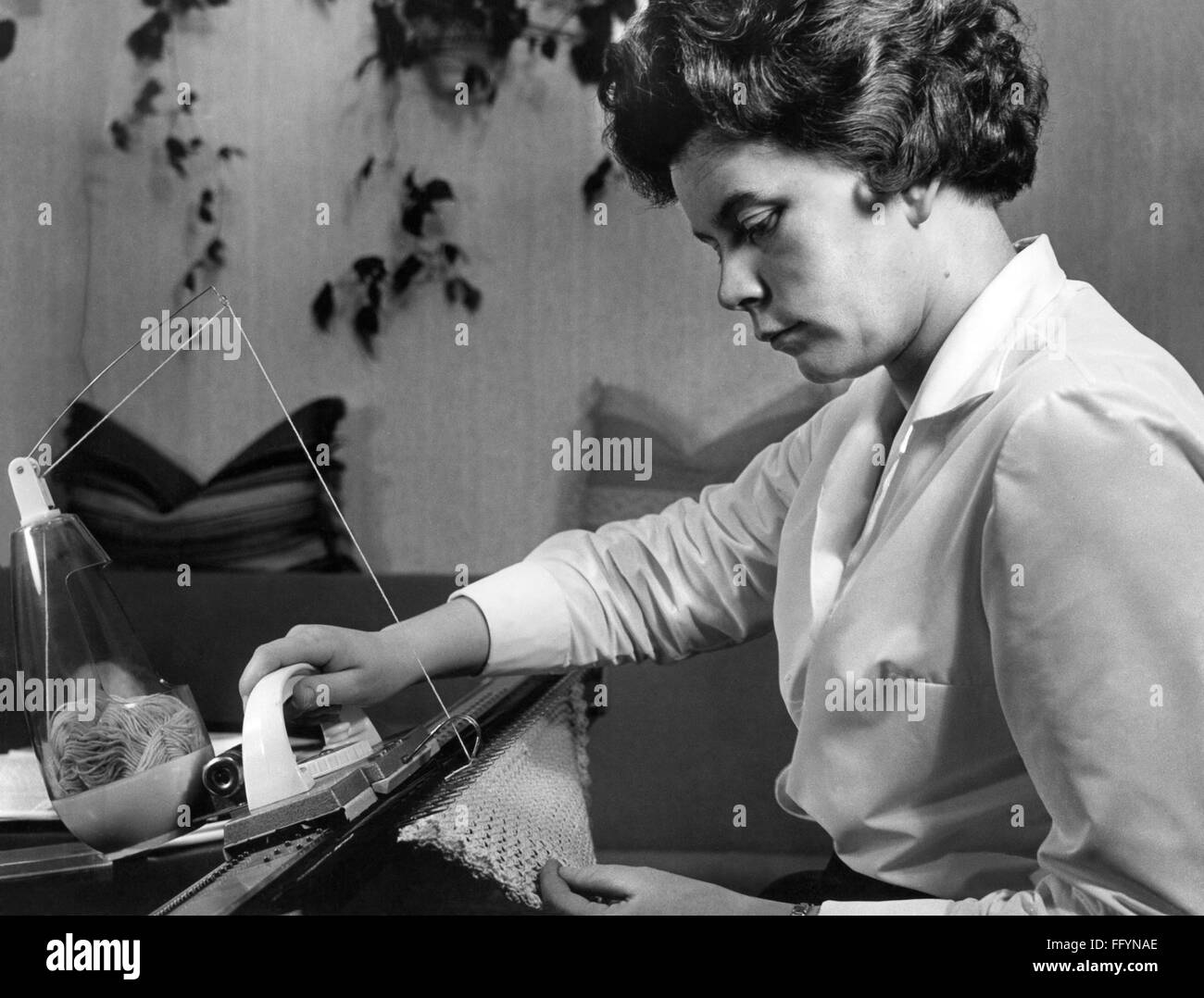 household, needlework, woman with knitting machine, 1962, Additional-Rights-Clearences-NA - Stock Image
