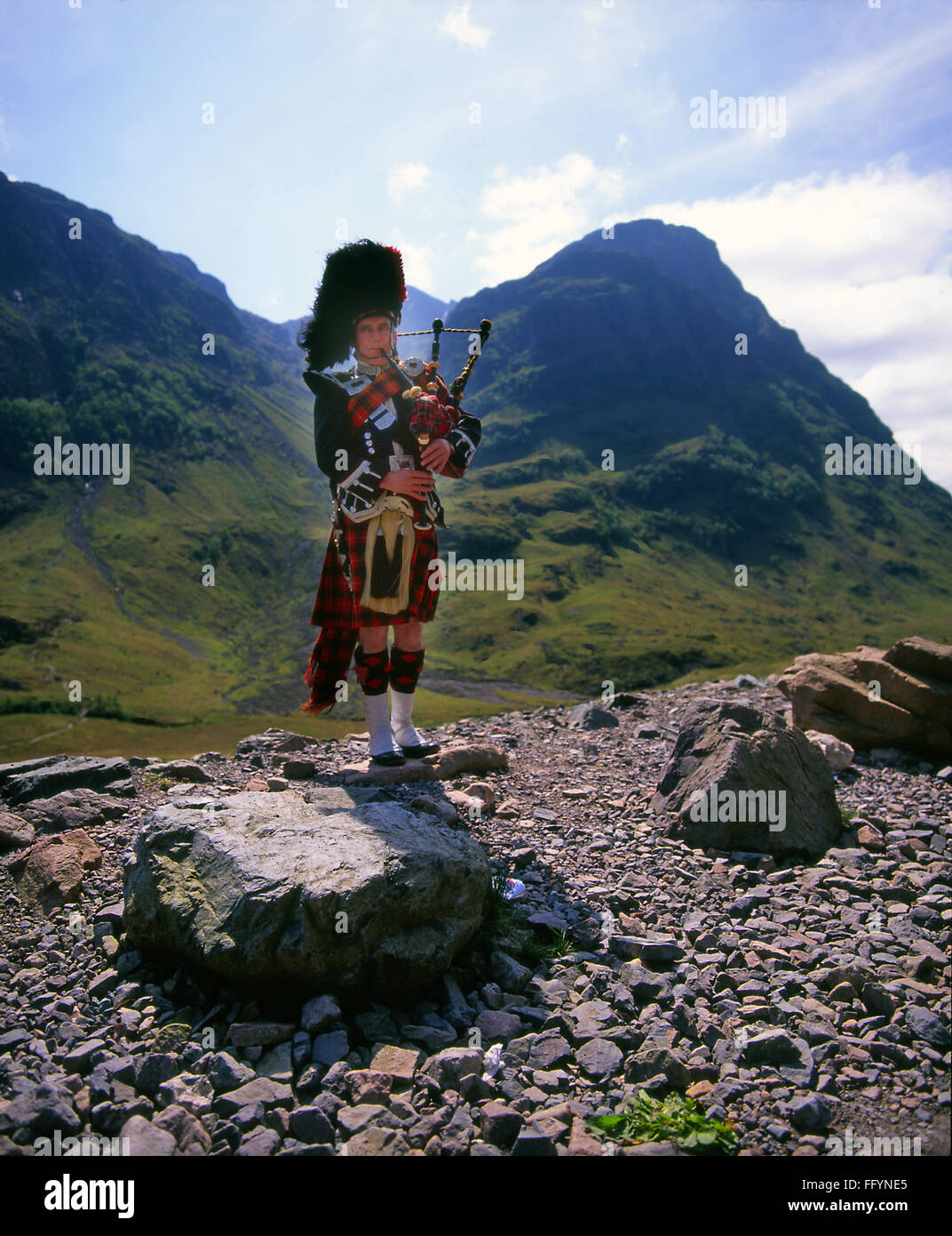 Piper in Glencoe, West Highlands - Stock Image