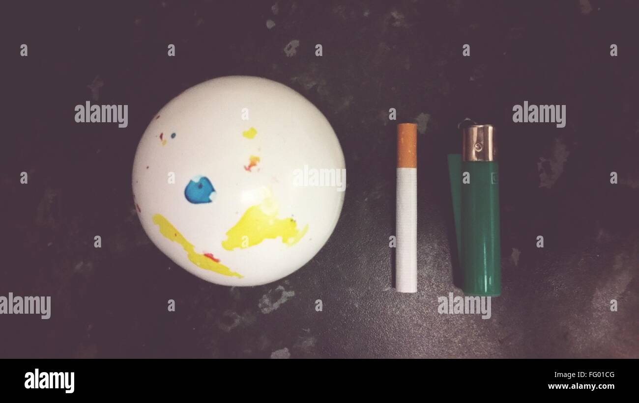 Directly Above View Of Cigarette With Lighter In Dark - Stock Image