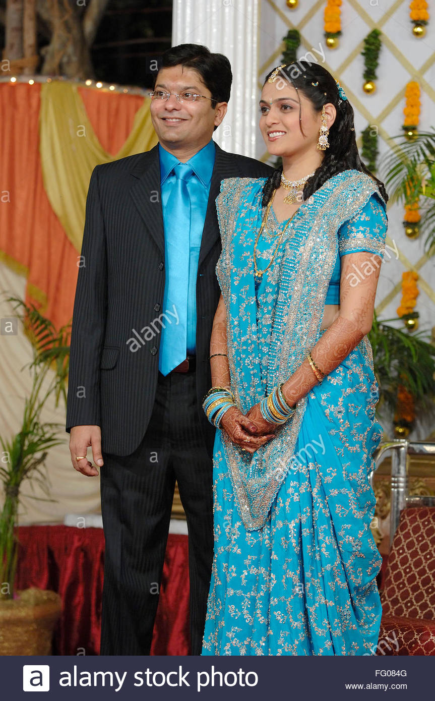 Bride and bridegroom standing for wedding reception in Indian Hindu ...