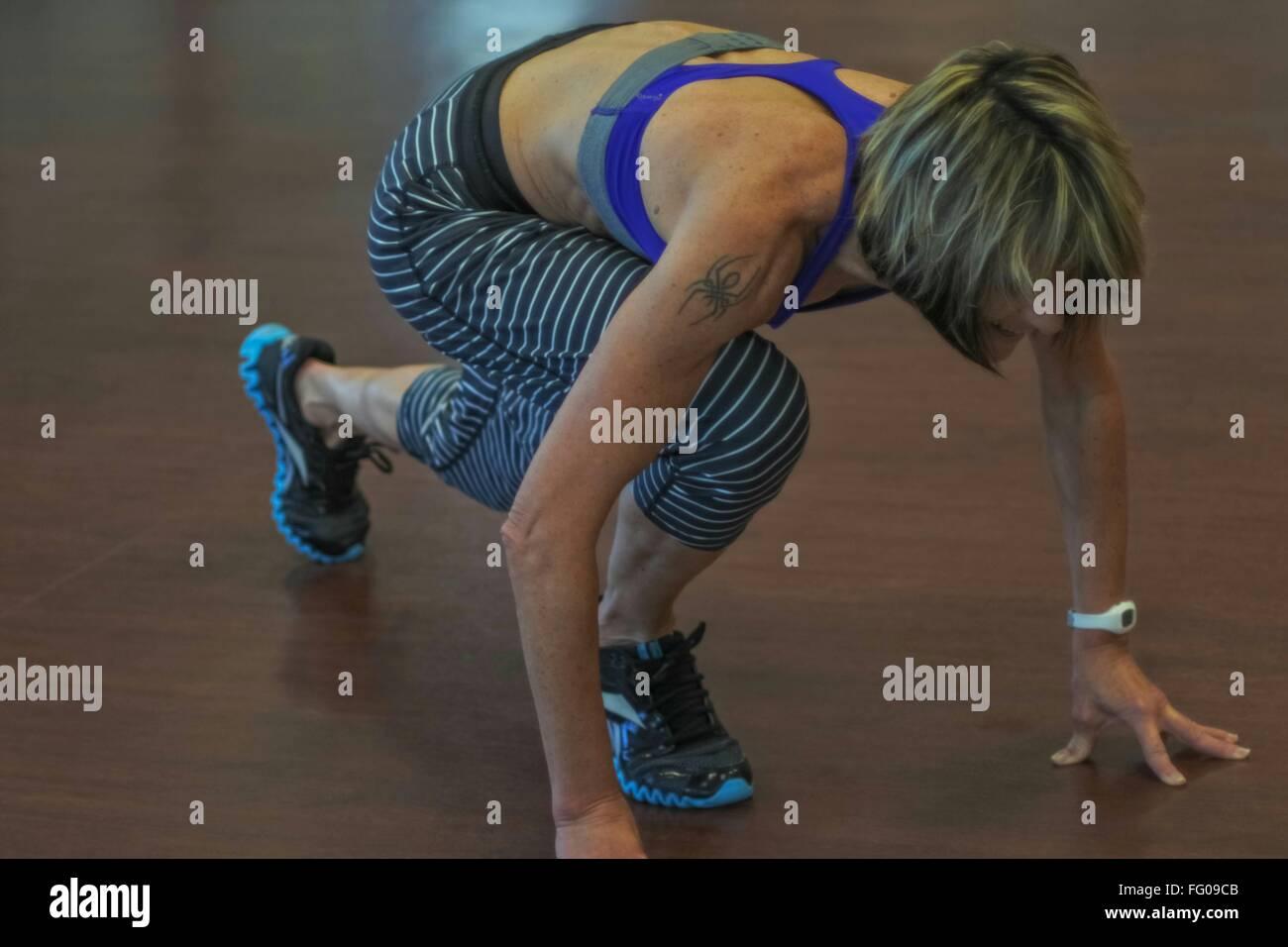 Athletic Female Sprinter On Starting Blocks - Stock Image