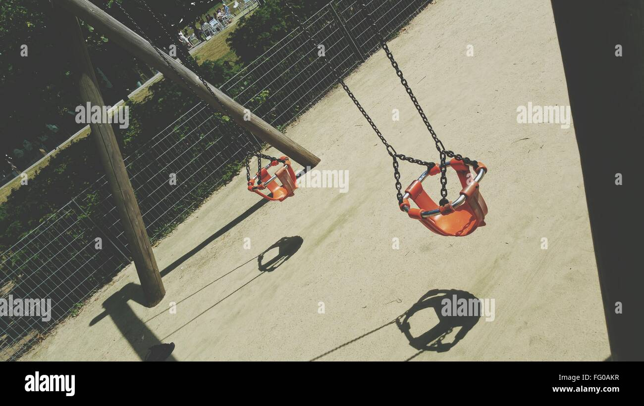 High Angle View Of Swings In Park - Stock Image