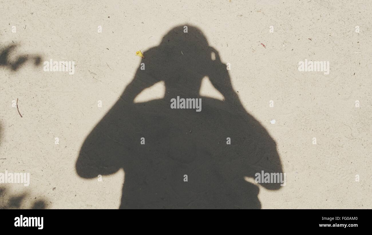 Shadow Of Person Taking Self Portrait - Stock Image