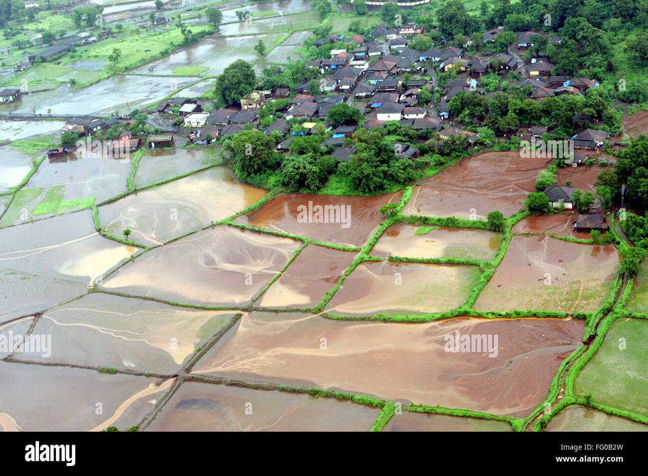 An aerial view of entire village and farming land immersed in water flood rocked in Raigad , Maharashtra , India - Stock Image