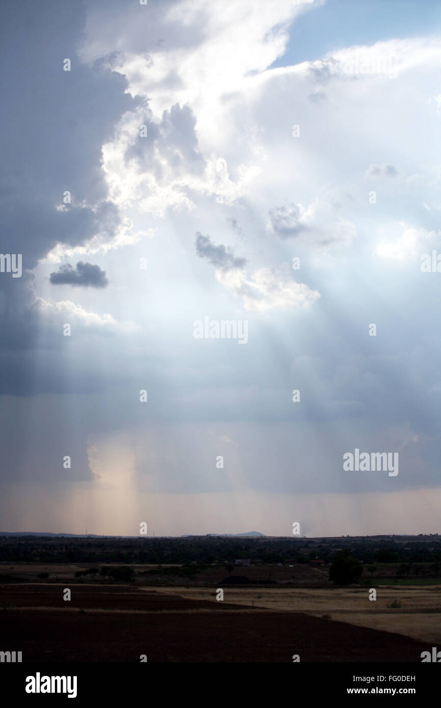 Sunrays from below clouds - Stock Image