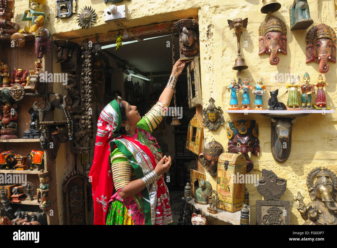 Lady In Colourful Traditional Dress Looking At Handicraft Items