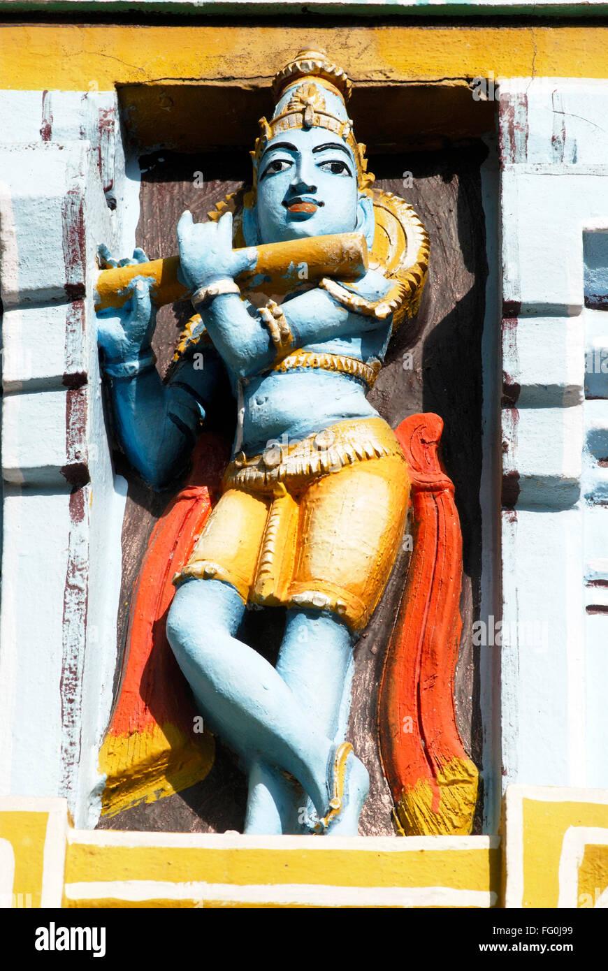 Colourfully painted statue lord Krishna playing flute bansuri facade Sri Ranganathswami temple complex Srirangam - Stock Image