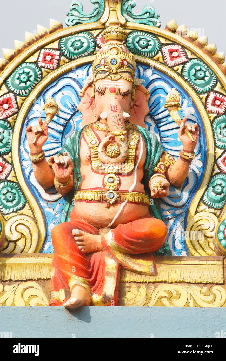 Colourfully painted stucco statue of lord Ganesh ganpati on temple , Thanjavur , Tamil Nadu , India - Stock Image