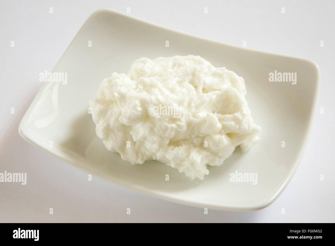Butter made from full cream milk into yogurt home or dairy product in plate - Stock Image