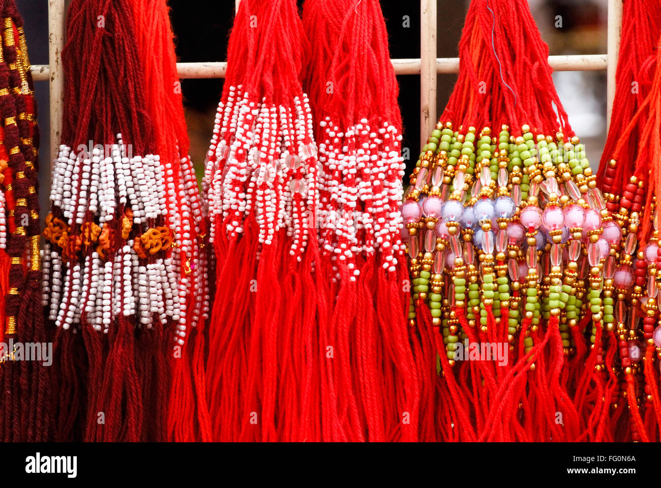 Colourful holy threads used to tied on wrists for protection from bad sights - Stock Image