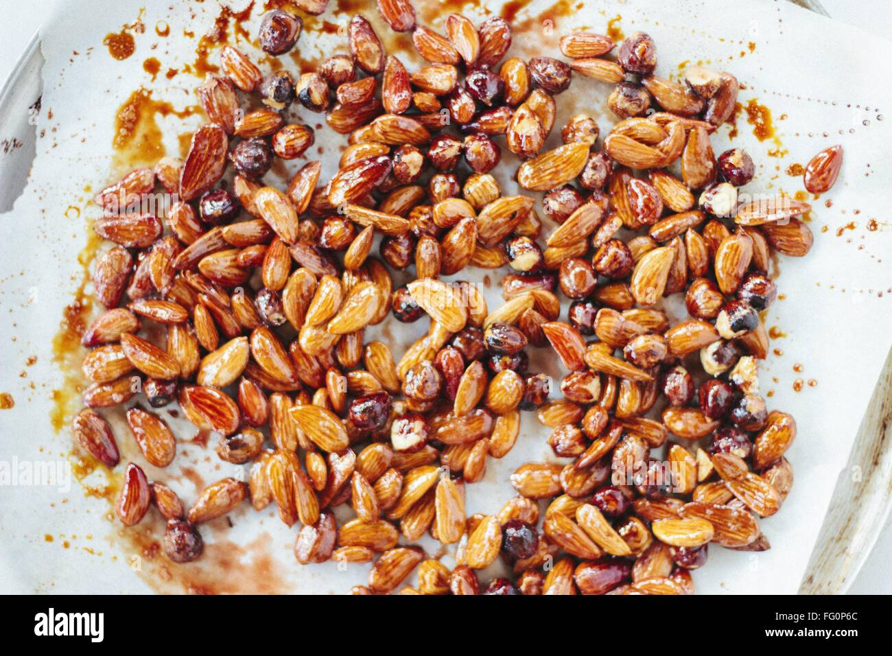 Almonds With Syrup On Baking Sheet - Stock Image