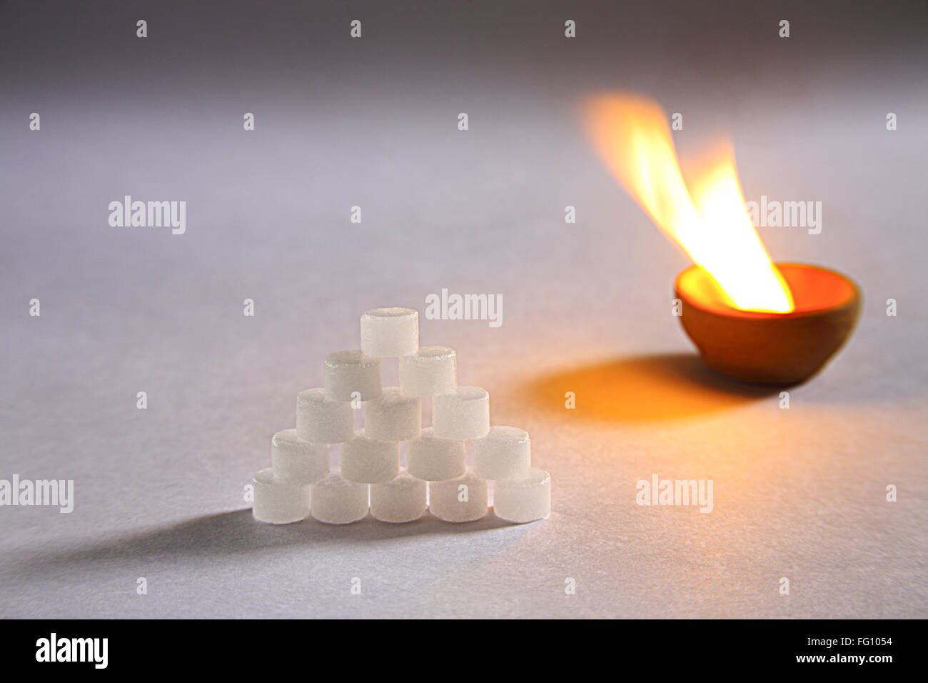 Concept , kapur or camphor camphora officinerum use as ayurvedic medicine with burning in panti on white background Stock Photo