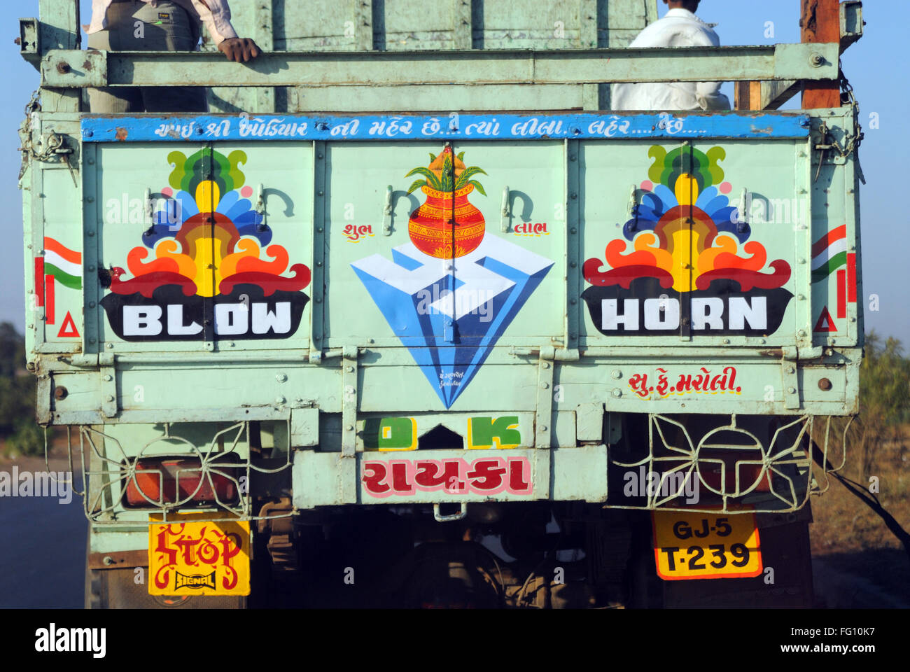 Truck with message blow ok horn painted at backside - Stock Image