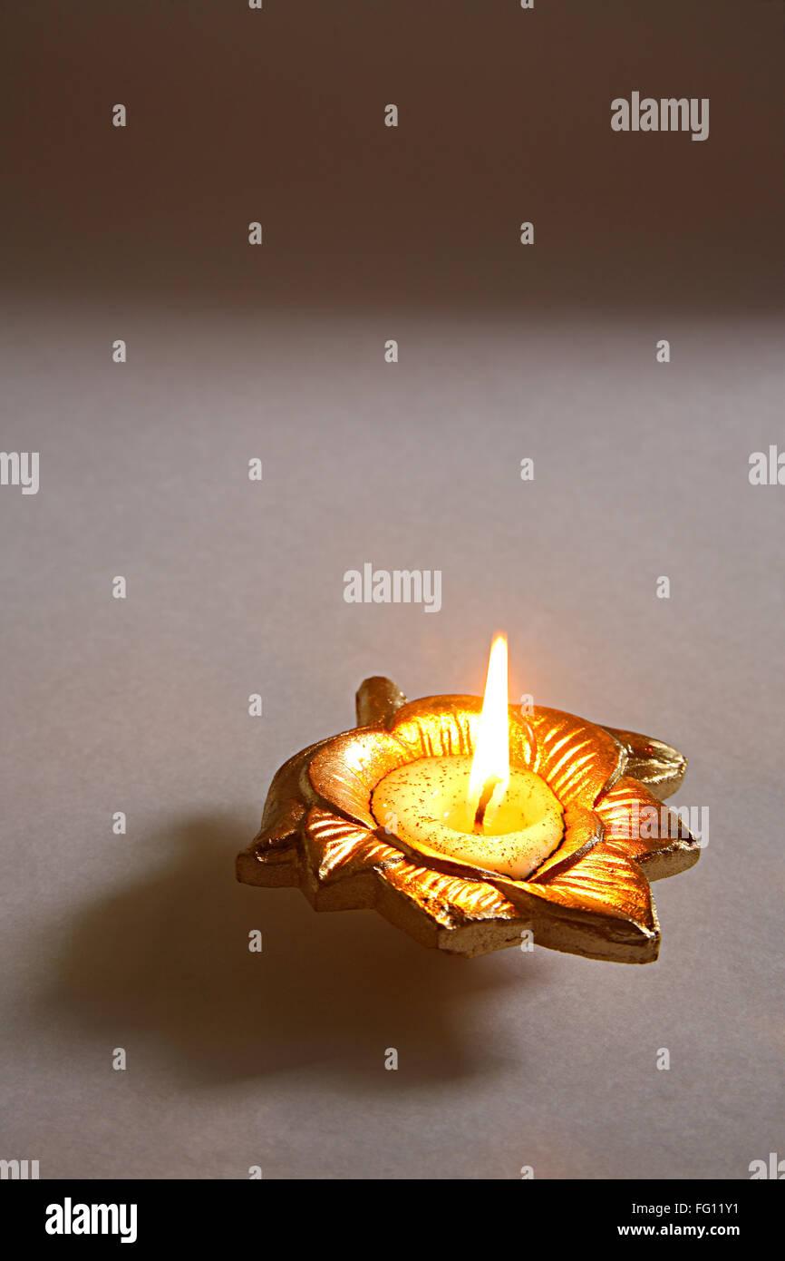 Indian festival Dipawali or diwali celebration diya clay oil lamp on white background , Bombay Mumbai , Maharashtra Stock Photo