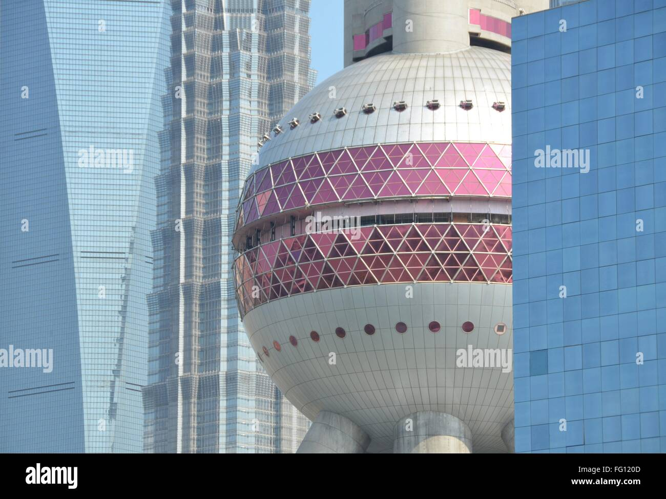 The Oriental Pearl Tower between highrises of the financial district in Pudong, Shanghai. - Stock Image