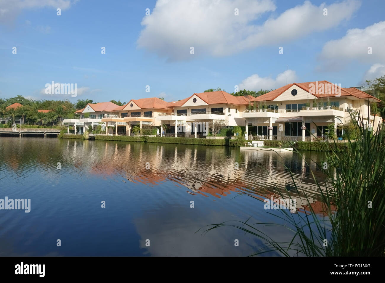 A residential houses around a lake Soi Nichida Thani in Pakkret, Northern Bangkok suburbs Stock Photo