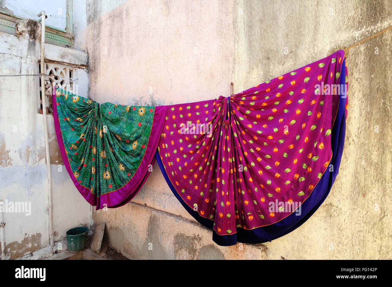 Colorful Ghagras drying outside Village House at Gujarat India - Stock Image