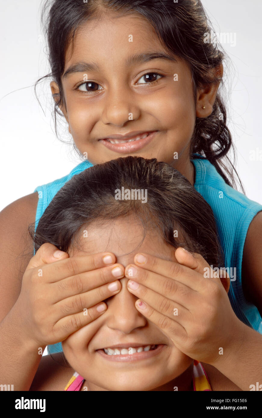 South Asian Indian two girls playing hide and seek game MR#364 - Stock Image