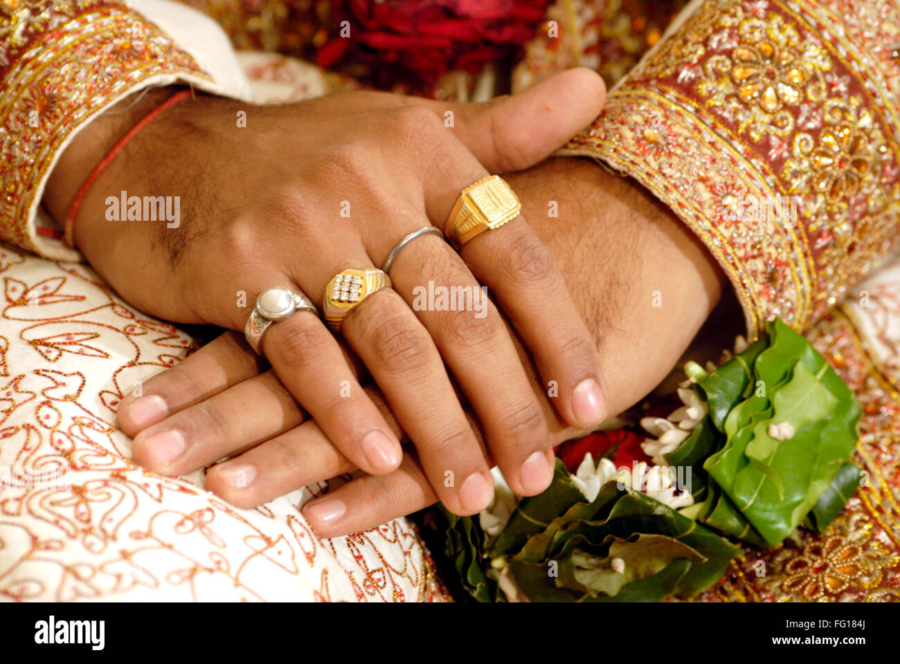 South Asian Indian Hindu wedding ceremony close up of hands cross