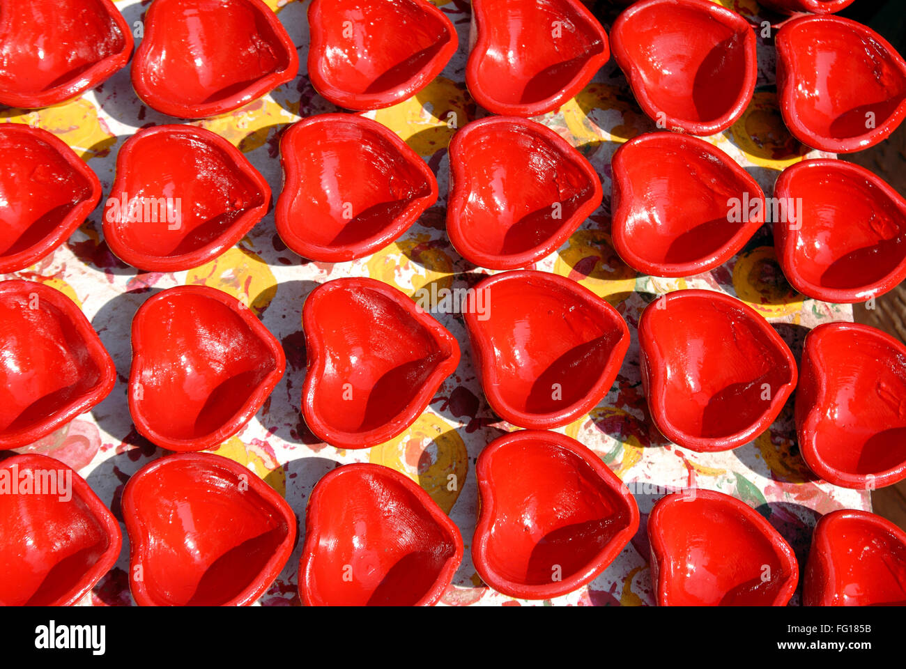 Red oil lamps made of mud drying Stock Photo