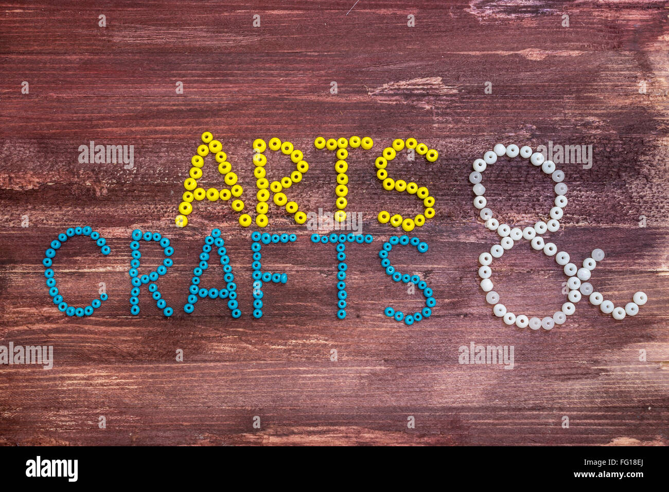 Arts Crafts Written With Beads On A Wooden Background Stock Photo Alamy