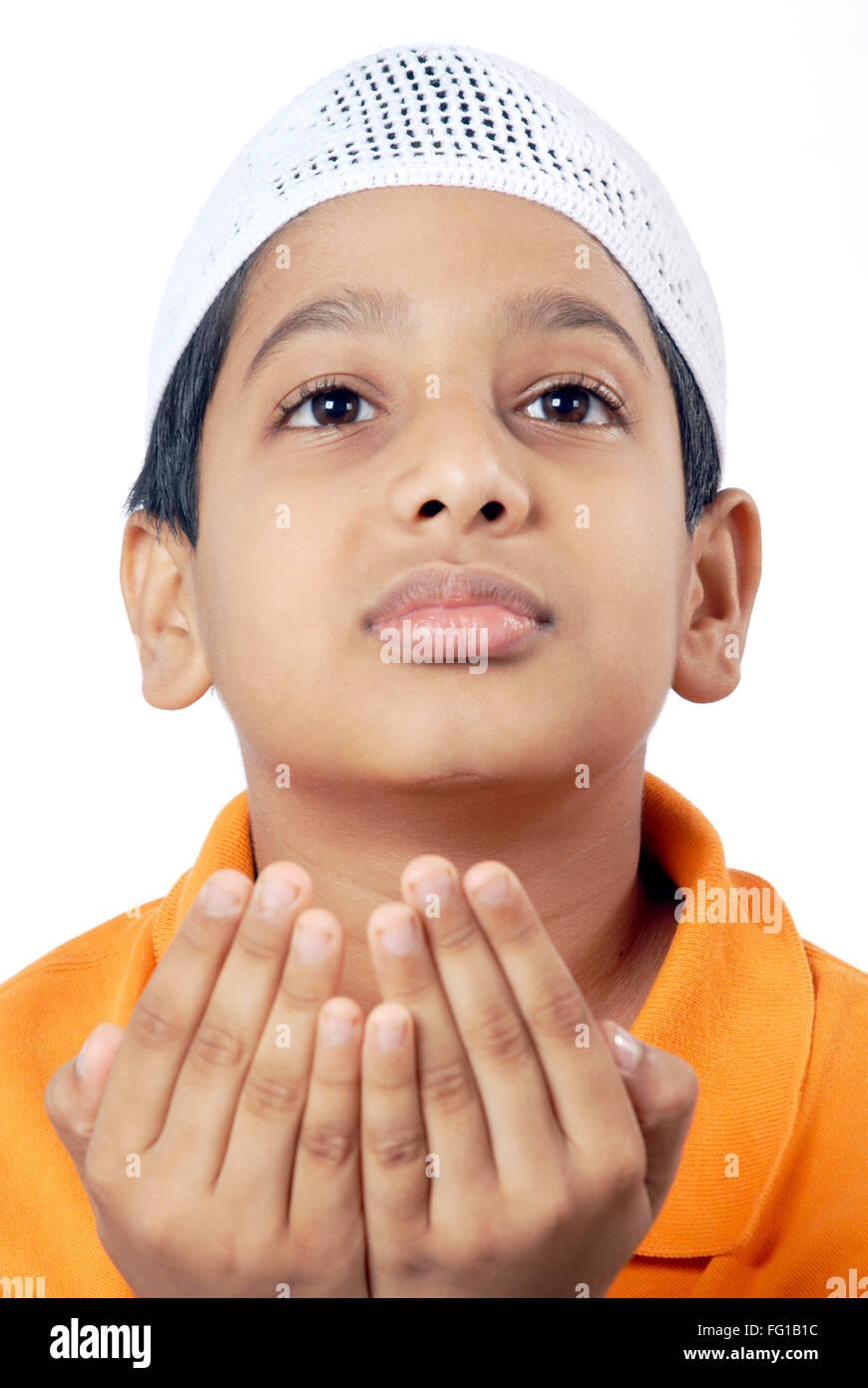 Muslim boy wearing topi praying namaz MR#152 - Stock Image