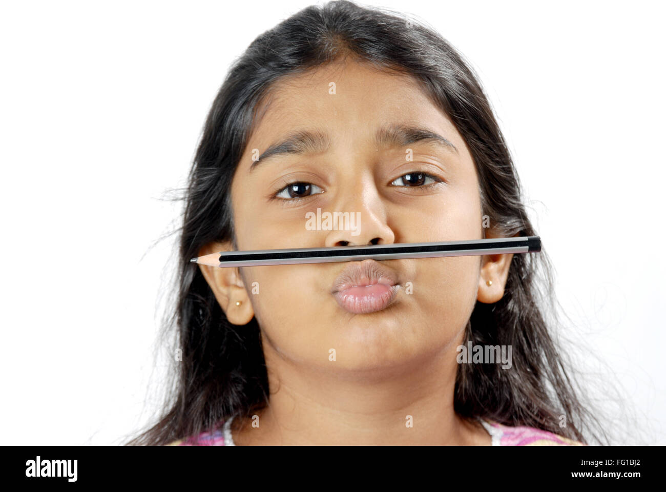 Young naughty girl kept pencil above lips MR# 152 Stock Photo
