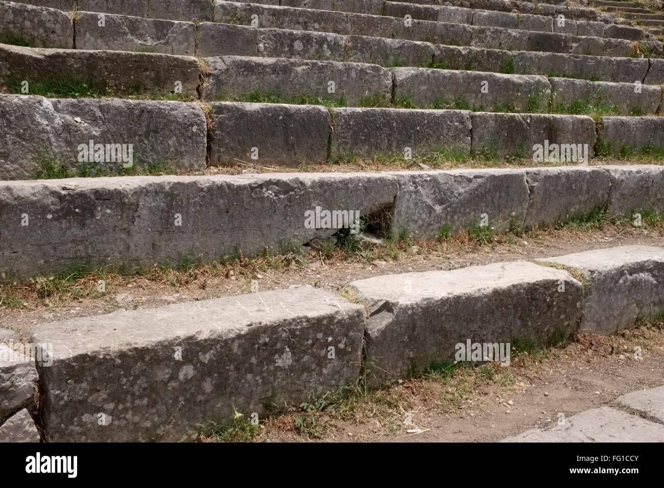 Ancient seating in the Greco0Roman theater [theatre] in Taormina - Stock Image