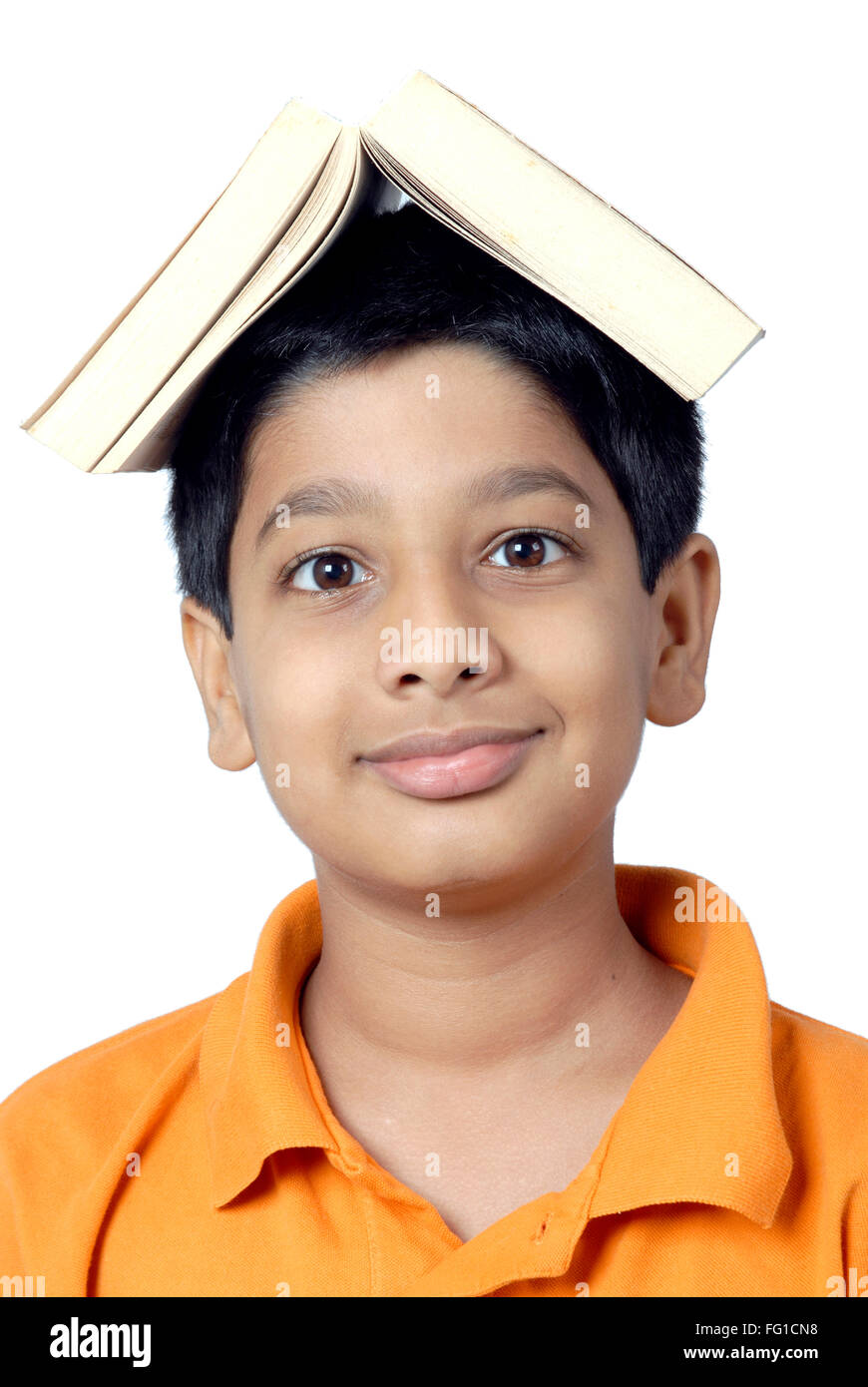 Young boy kept book on head showing burden MR#152 - Stock Image