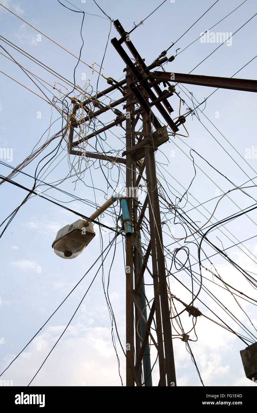 Electric pole with power supply wires chaos , Cochin now Kochi Stock ...