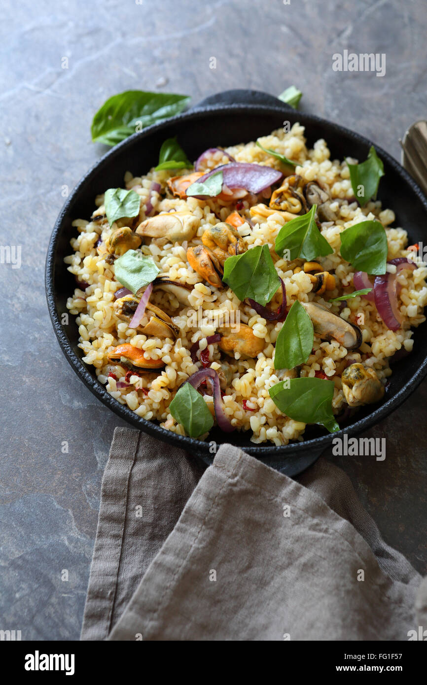 bulgur in pan, healthy food Stock Photo