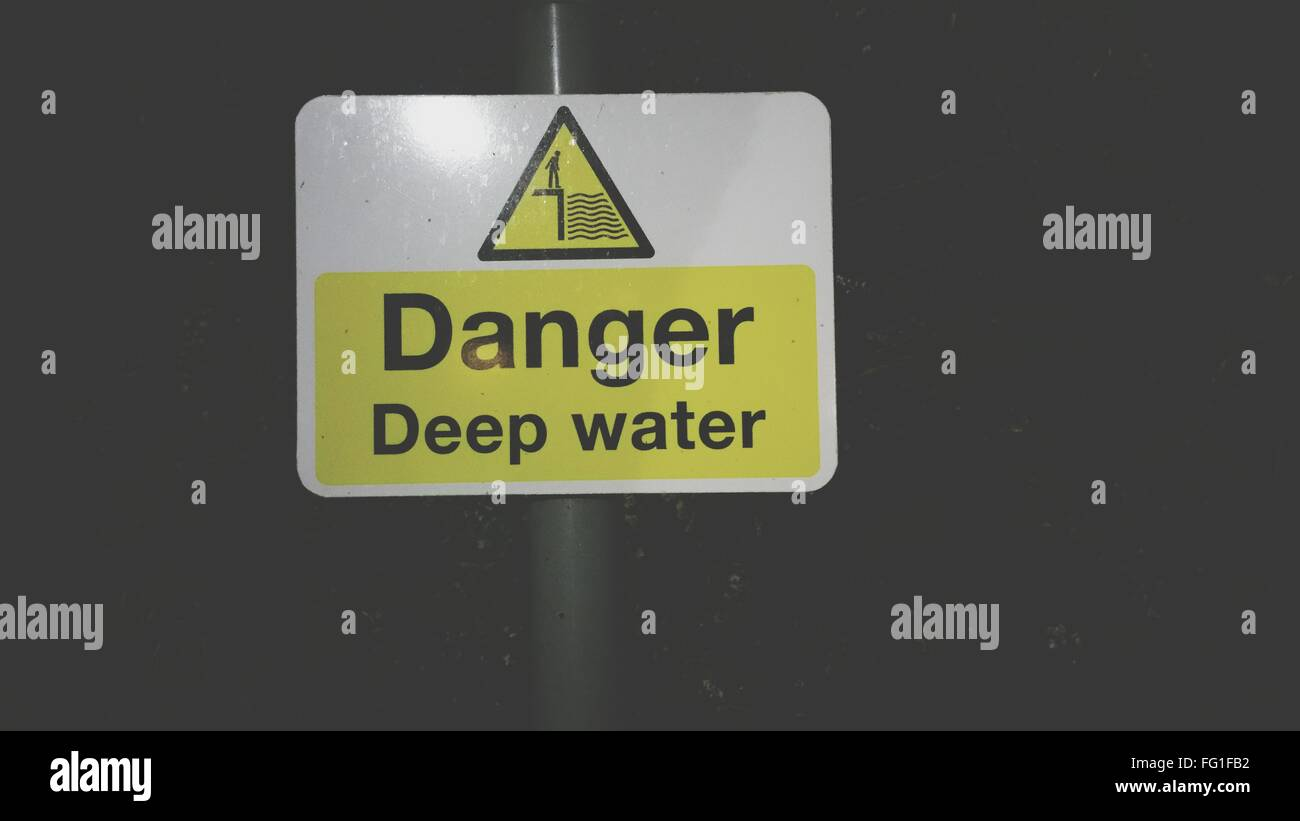 Close-Up Of Sign Board On Wall - Stock Image