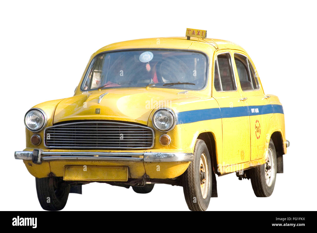 Yellow taxi Hindustan Ambassador an automobile manufactured by Hindustan Motors of India on white background - Stock Image
