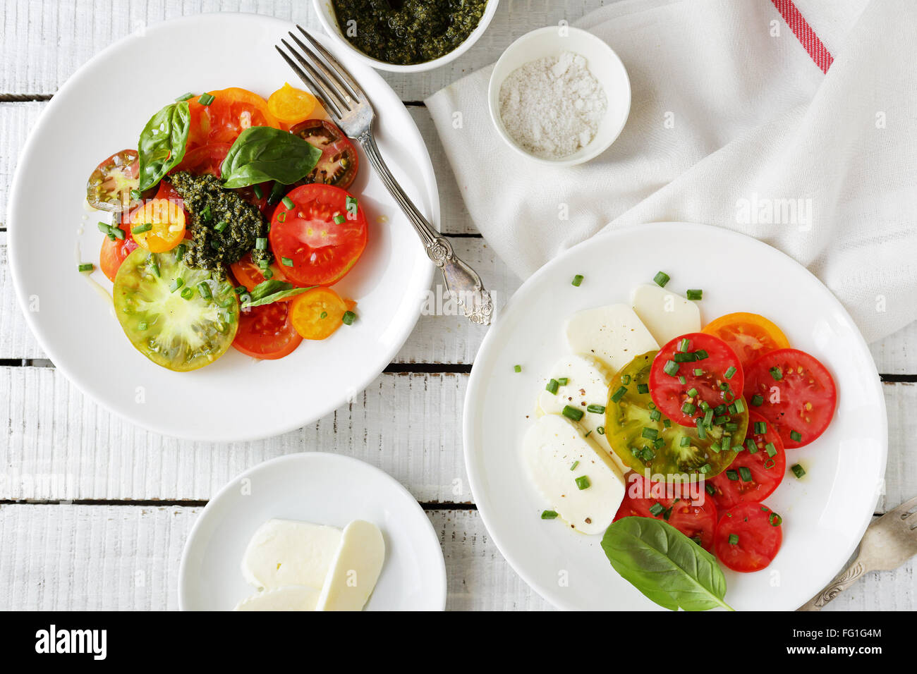 italian caprese salad and tomato on plate, food top view - Stock Image
