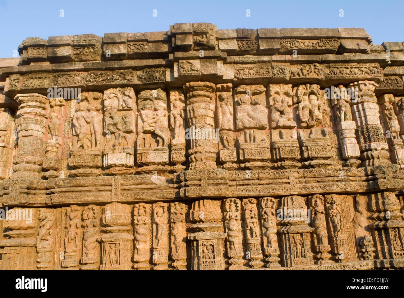 Wall of 13th century Sun temple carved with images representing everything mundane and mythological Konarak Orissa - Stock Image