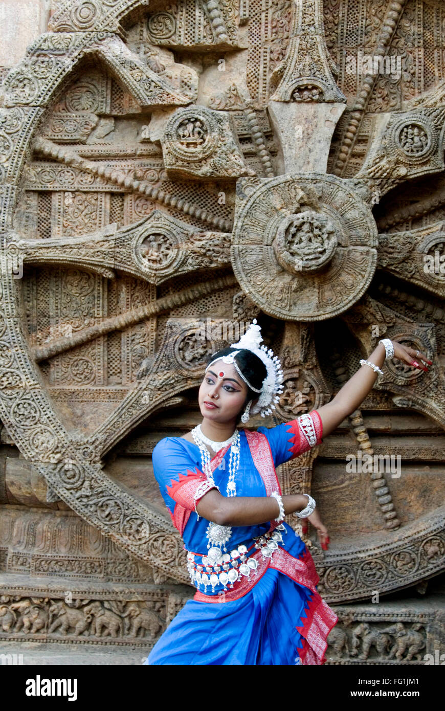 Odissi dancers strike pose re enacts Indian myths such as Ramayana iconic Sun Chariot Sun temple complex Konarak - Stock Image