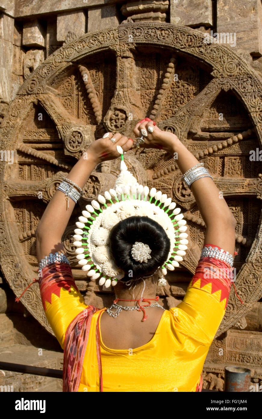 Odissi dancers strike pose re enacts Indian myths such Ramayana front iconic Sun Chariot Sun temple complex Konarak - Stock Image