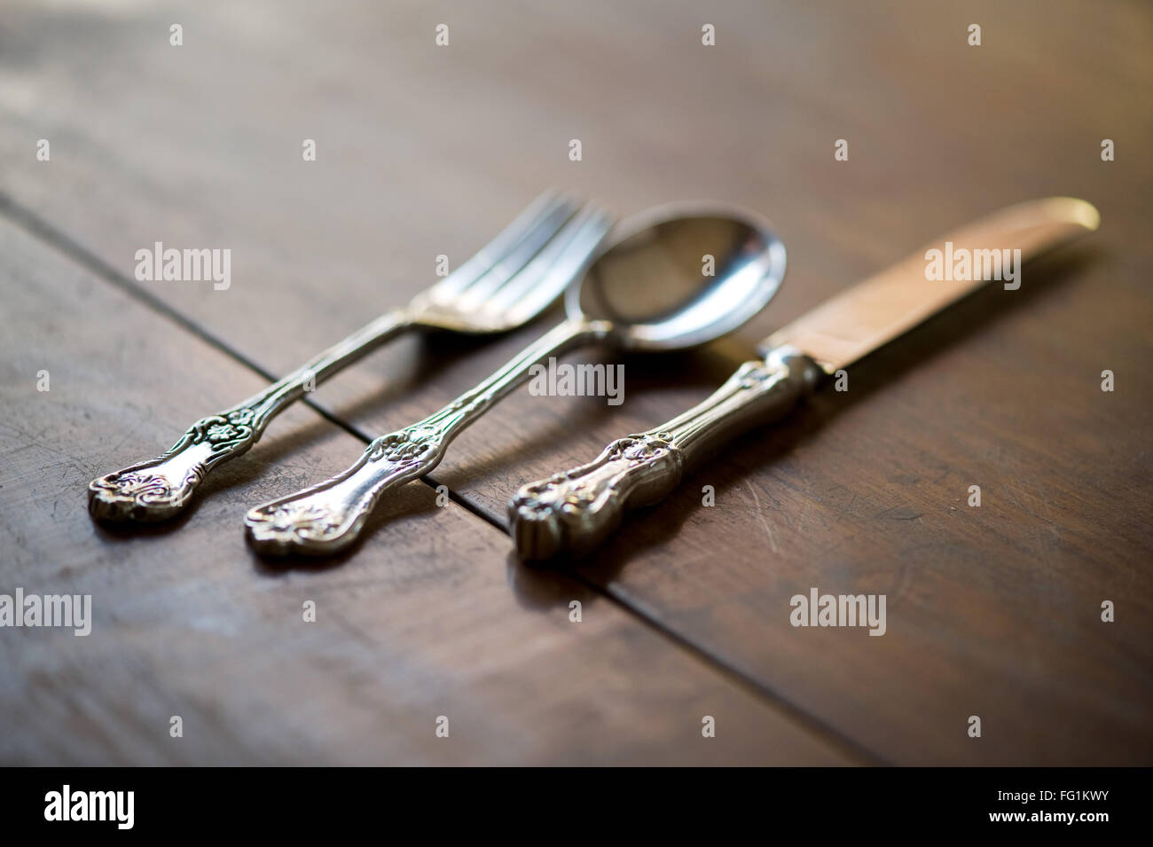 Silverware on table ; India - Stock Image