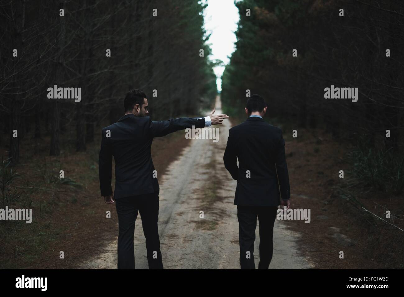 Man Pointing Fingers At Other Man - Stock Image