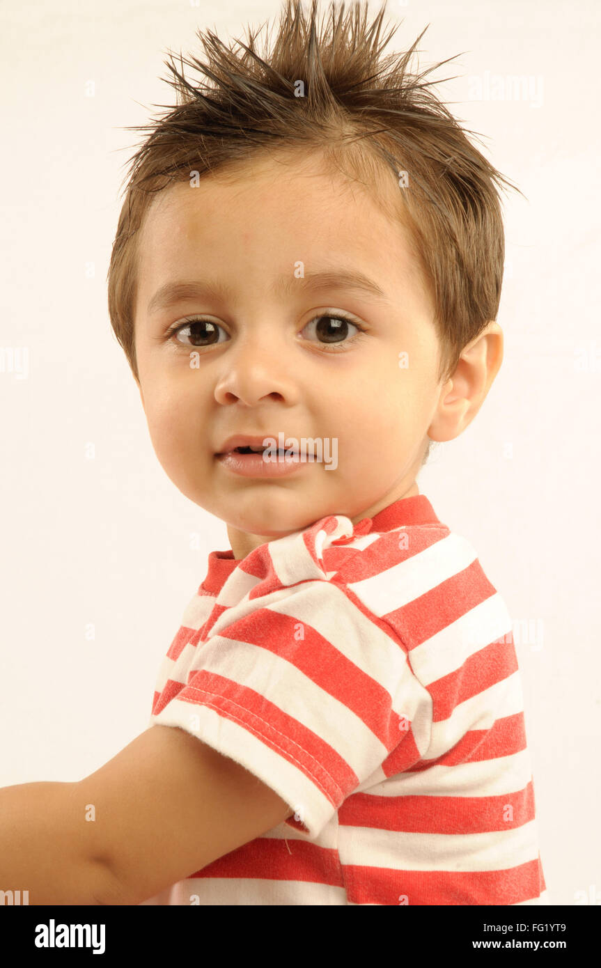 Boy with spiked hair looking anxiously with broad eyes MR#686O 29 June 2008 - Stock Image