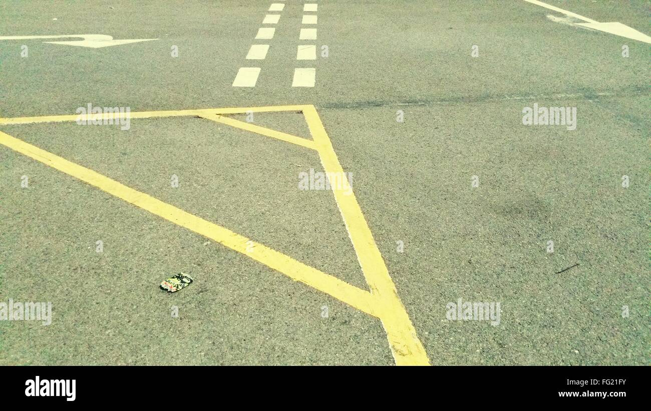 High Angle View Of Yellow And White Markings On Road - Stock Image