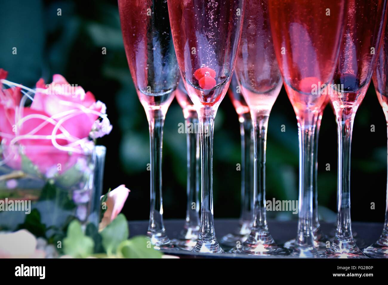 Cocktails In Flutes On Table - Stock Image