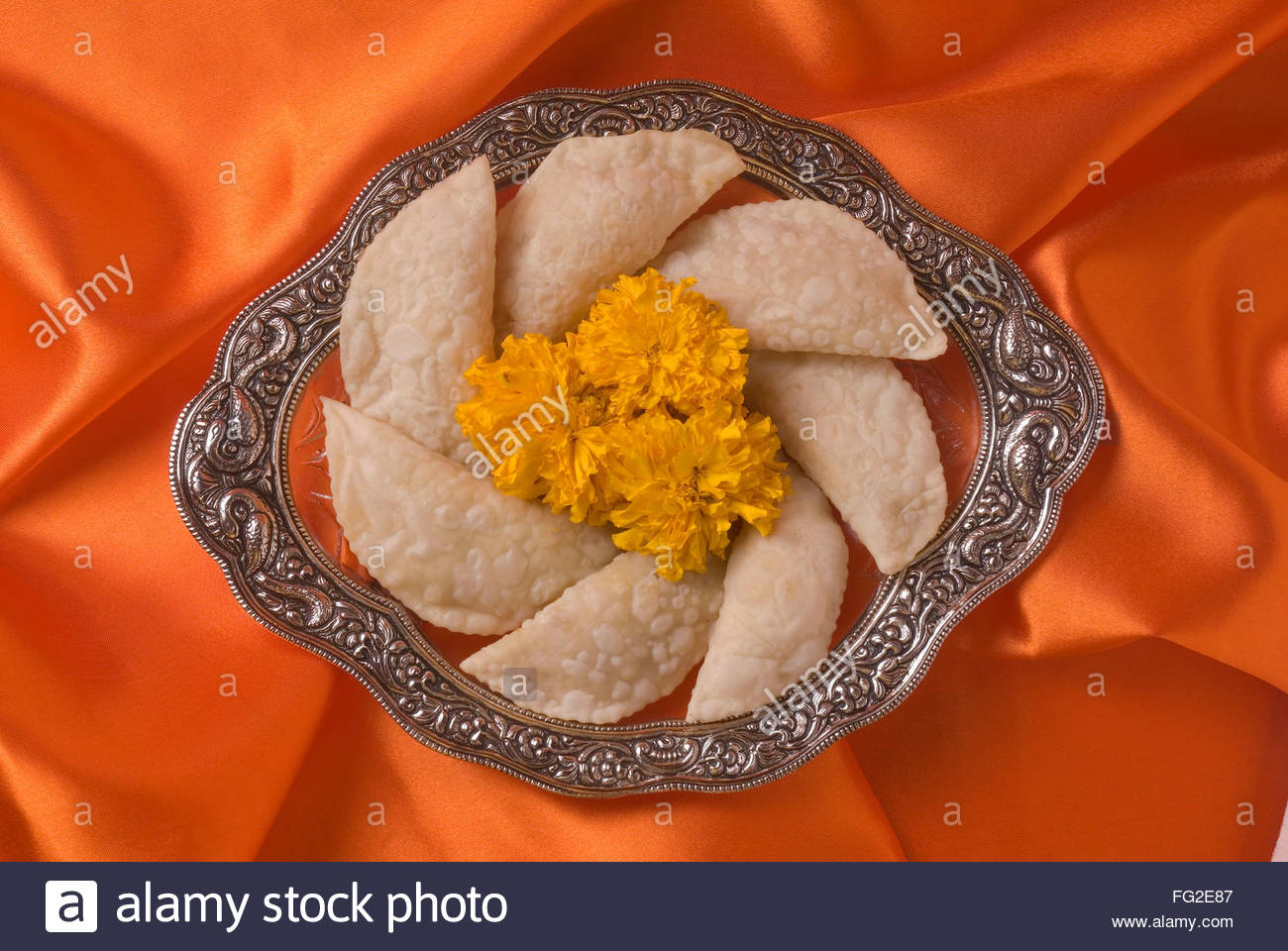 Karanji a sweet cake like stuffed eatable during Diwali deepawali festival , India - Stock Image