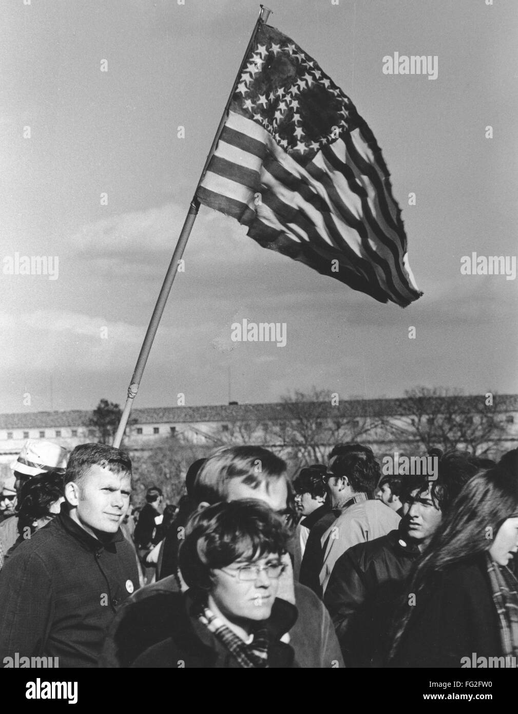 ANTI-WAR PROTEST, 1969. /nProtesters waving an American flag with a peace sign demonstrate on the Mall in Washington, Stock Photo
